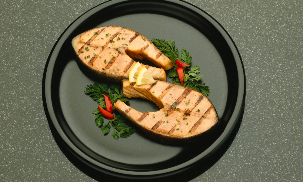Salmon steaks seasoned and grilled just right make a wonderful main dish.