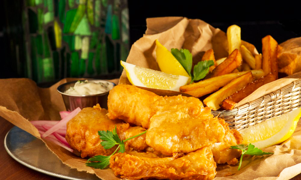 Celebrate St. Patrick's Day with classic Irish pub-style fish and chips. Unlike English fish and chips, which were traditionally serve in folded newspaper, these light crispy beer battered fish and chips are served Irish pub-style piled on rustic torn brown paper bags with fresh-made tartar sauce, lemon and malt vinegar.