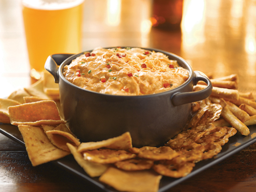 Here's a classic Big Game party recipe. This robust creamy dip tastes like Buffalo Chicken Wings but without the mess! Serve hot with celery sticks, veggies or your favorite chips.