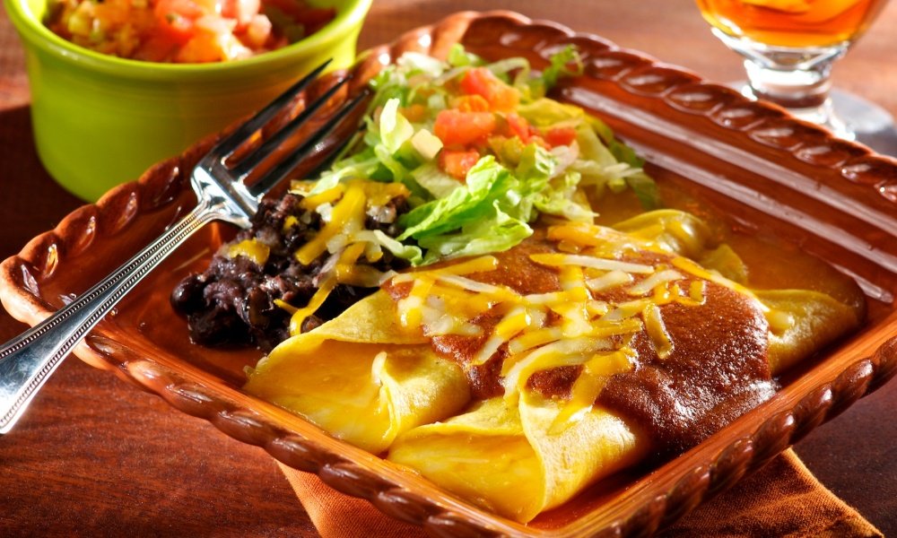 Not only is it Cinco de Mayo weekend, but it's also the weekend we celebrate enchiladas. They're not just for Cinco, you know, and are a fun, easy-to-prepare favorite at my family's gatherings all summer.