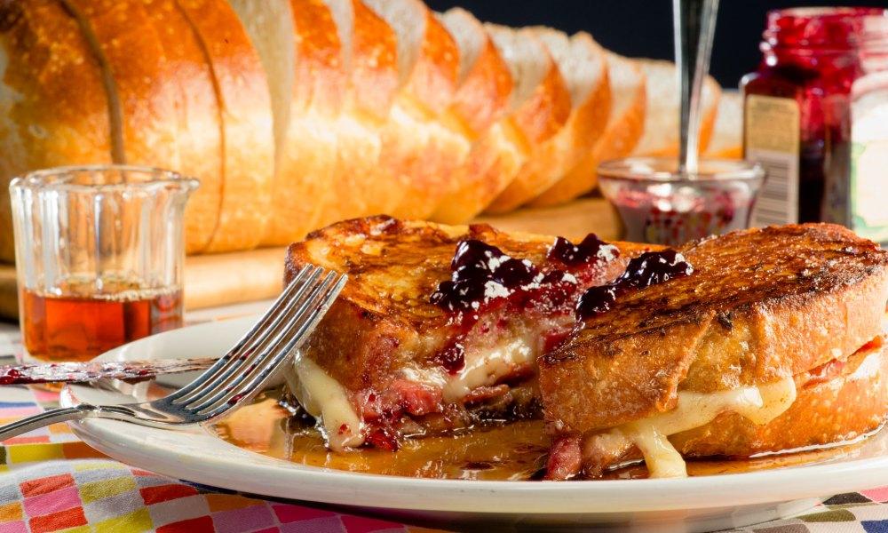 A delicious Monte Cristo sandwich on a plate.