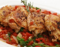 Pan-Braised Florida Chicken Thighs with Tomatoes, Garlic and Arugula
