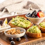Breakfast Board with Avocado Toast, Fruit, & Cheese