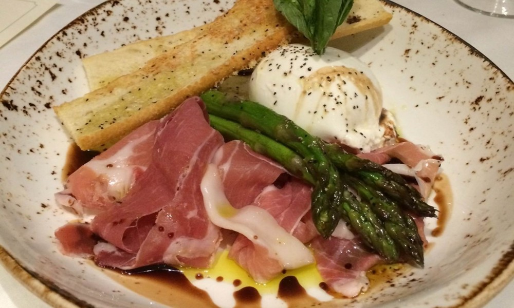 Burrata Prosciutto, one of the appetizer selections at Wollensky Grill