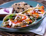 Soft Chicken Tacos with Caramelized Onions, Peppers and Horseradish Sauce