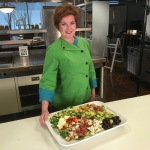 Chef Cari shows the completed cobb salad, ready to eat!