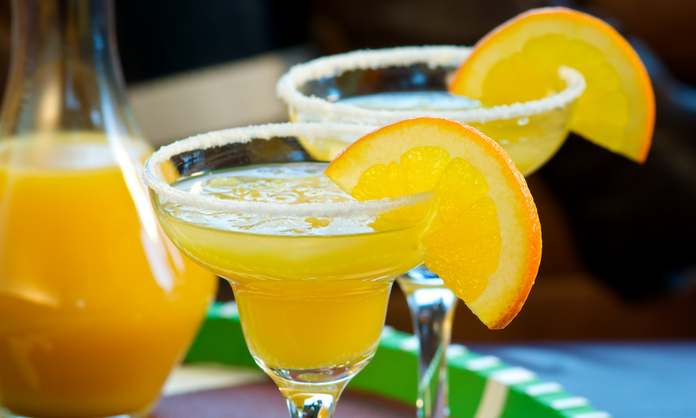 "A margarita is a traditional cocktail made with tequila, triple sec and lime juice served either on the rocks, blended with ice or straight up. The earliest mention of the Margarita was in 1938 by Carlos ""Danny"" Herrera in Mexico, which was created for a customer who was allergic to all other spirits but tequila."