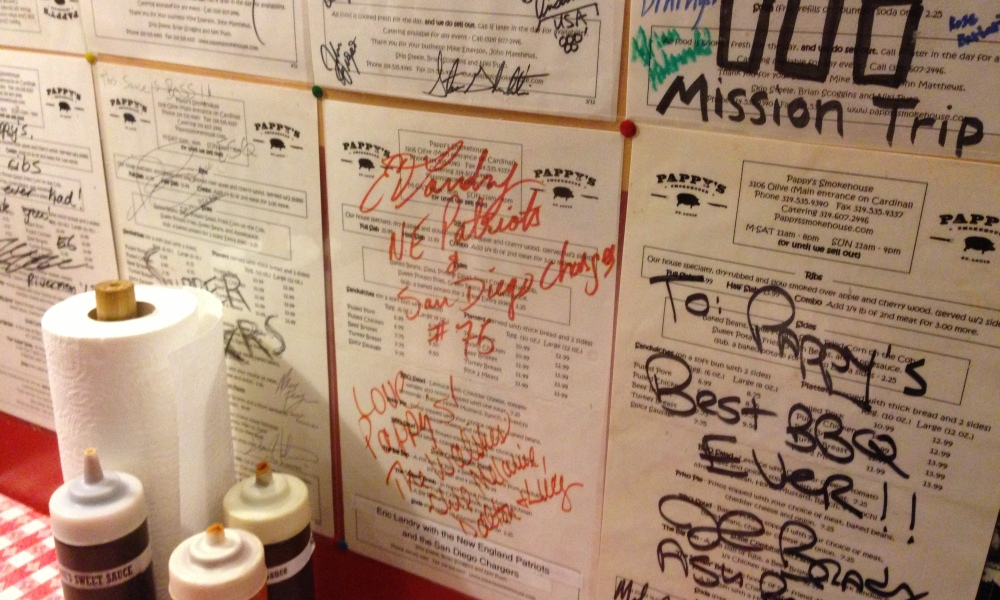 Signed menus from celebs and friends line the walls.