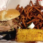 Pulled pork with fried corn and sweet potato fries.