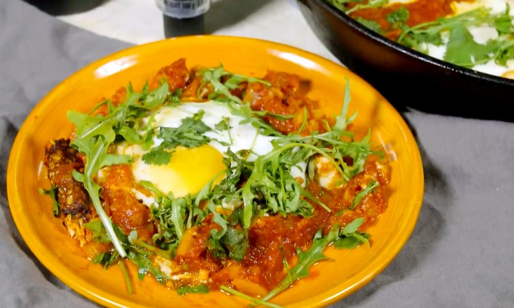 A delicious Mediterranean egg dish that will satisfy your appetite with an exotic blend of spices in a rich sauce enveloped by fried eggs, called Shakshuka!