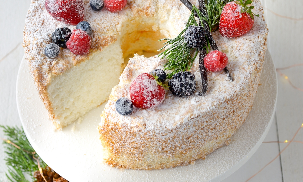 In A Heavenly Christmas, the heroine learns that angels can eat as much as they want without gaining weight (we need that super power!), so at Max's diner, she orders two kinds of pie and a slice of angel food cake. This recipe for Heavenly Angel Food Cake is light, fluffy, beautiful and heavenly, of course!