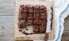 These fudgy brownies double down on bacon by sprinkling some on top AND adding the rendered fat to the dough. They are chewy, decadently delicious and everyone will love them!