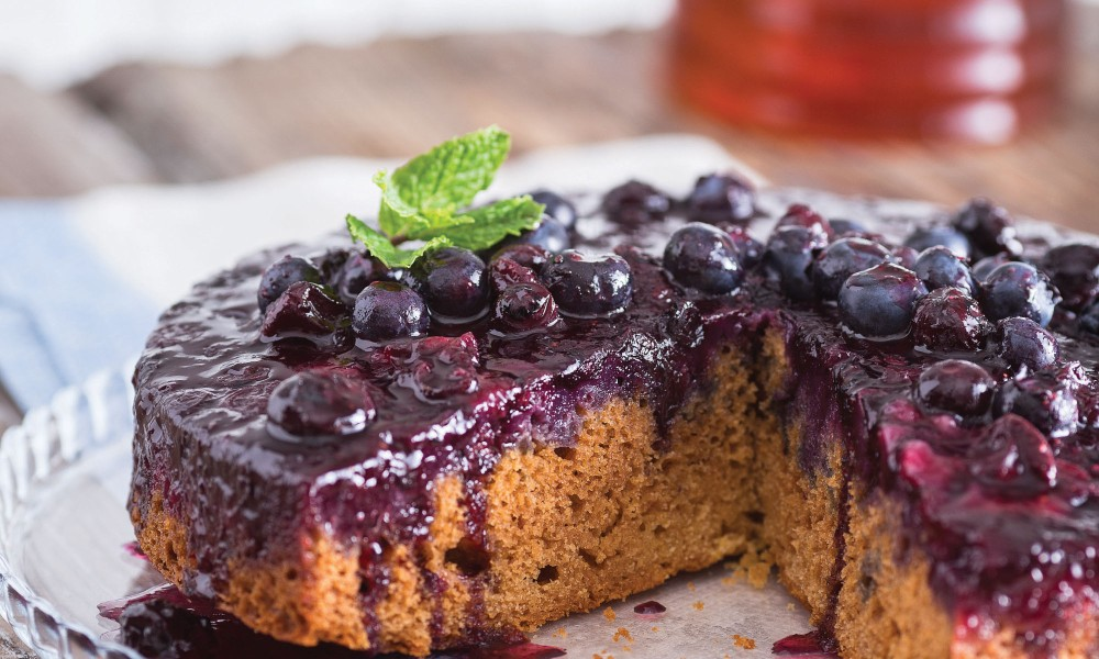 When it comes to coffee cake in general, you can thank the Danes. For this particular recipe for Blueberry Coffeecake, you can thank our friends at the National Honey Board. Start with thin layers of cornmeal and blueberries, sprinkled with flour, filled with delicious batter, and for dramatic flair, invert the baked coffeecake for a crown of beautiful blueberries.
