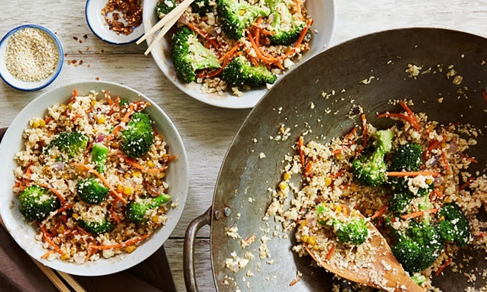 This mouthwatering Cauliflower Fried Rice is made by combining the fresh flavors of cauliflower rice, broccoli, carrots, corn, red onion and Asian spices, into one dish that is bursting with flavor. From start to finish, this dish only takes 20 minutes to create.