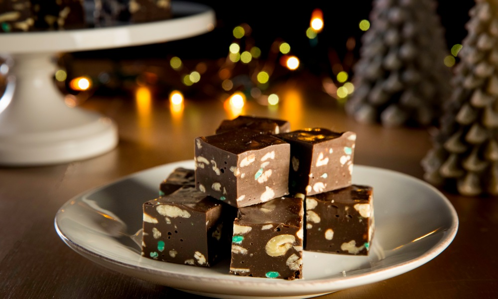 'Tis the season to pop a delectable morsel in your mouth and let it melt all your cares away! Nothing does that like the combination of mint and chocolate unless you want to add the nice crunch of pecans to keep yourself grounded. You'll love this fudge, not only for its escapism value, but also for how easy it is to make—no candy thermometer needed!
