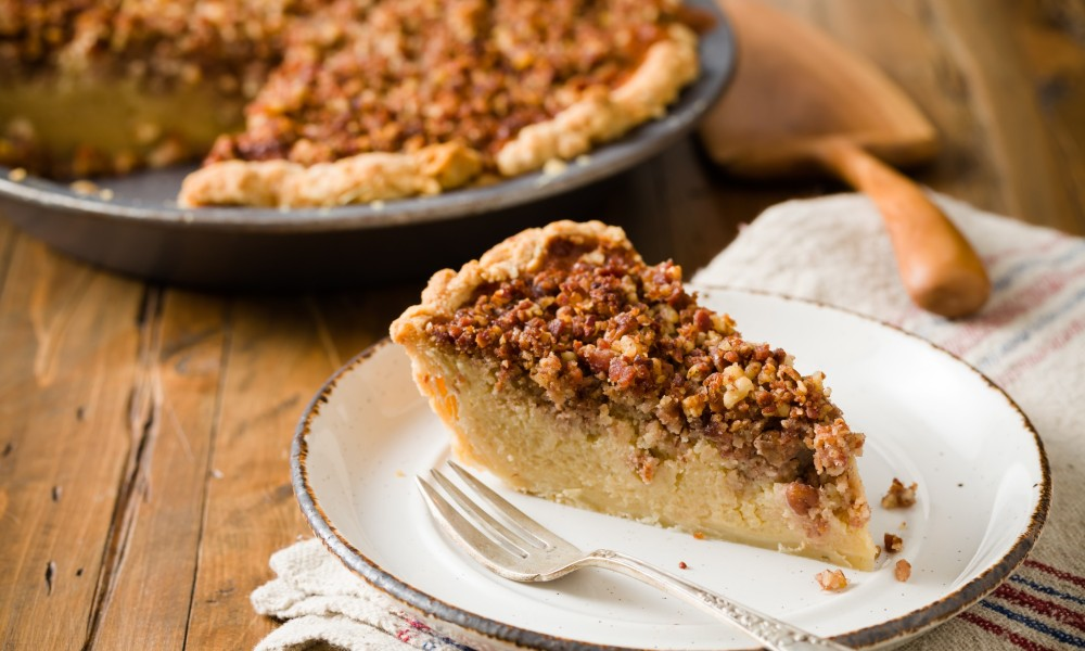 This delicious holiday recipe for Maple Bacon Idaho® Potato Pie brings some new twists to an an old classic. Filled with Idaho Potatoes, sugar, maple syrup and whipped cream, then topped with bacon and pecans. Bacon and maple are some of the hottest flavors this season and they make the perfect combination for this Potato Pie.