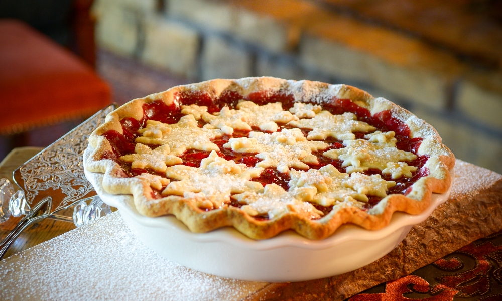In Christmas in Homestead, two of the main characters, a brother and sister, argue over the fact he's falling for another character named Jessica. To top off that spat, they argue over a piece of cherry pie. This recipe, inspired by the move and e-book, will give you a cherry pie so beautiful, it could be a table centerpiece itself.