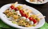 This simple tortellini antipasto skewers appetizer with fresh flavors can be assembled in minutes. It's ideal for parties or a satisfying anytime snack.