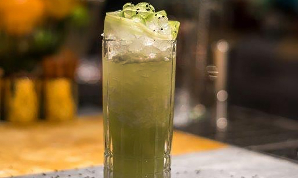 A twist on the traditional mojito, this invigorating and refreshing cocktail is made with rum, cold-pressed cucumber, and celery juice. It perfectly complements your crowd-favorite hot wings at the next Super Bowl party!