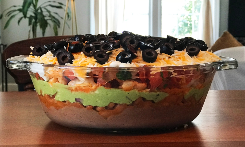 When you get the offer for an exclusive Super Bowl game-day recipe from one of America's top chefs...you take it! With great anticipation for the upcoming Super Bowl match between New England and Philadelphia, former Top Chef competitor, and judge, Chef Hugh Acheson, has created a fan-favorite 8-Layer Dip with a kick of heat thanks to his go-to Cholula Hot Sauce.