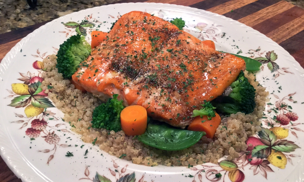 Hoisin sauce-glazed salmon atop a bed of rice made with chives, with freshly steamed broccoli on the side, this dinner is easy to make and the entire family is sure to love it.