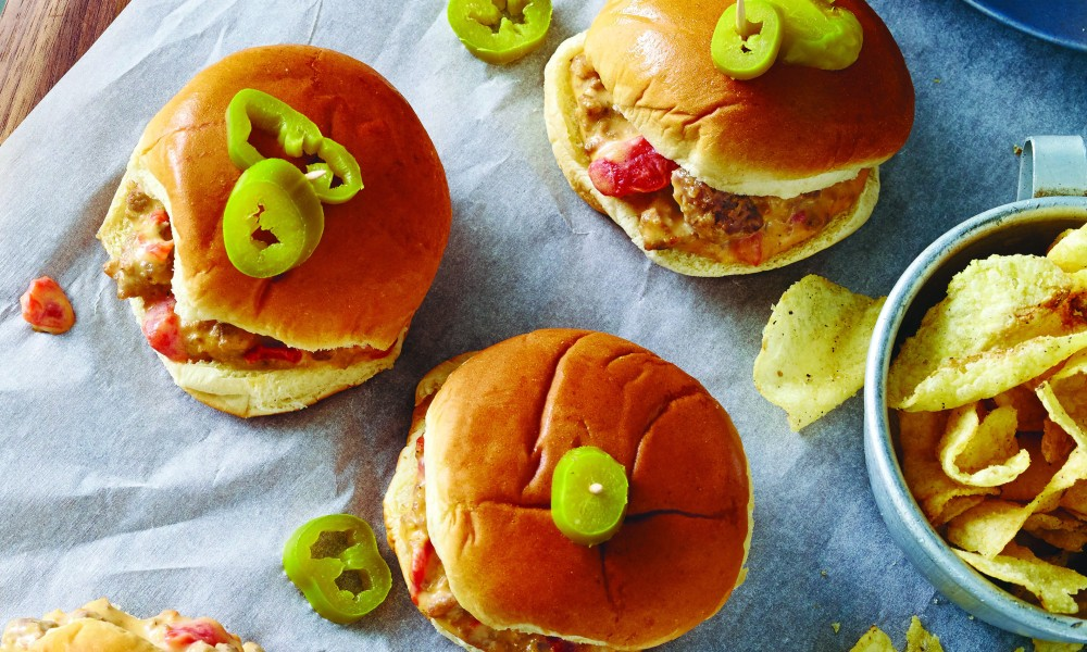When this recipe was given to us we chuckled a bit: Velveeta, sausage, Ro-Tel, and slider buns. What in the world could be so special about this family recipe? I think one of the girls in the kitchen even rolled her eyes. Well, let me just say that when we made these sliders we gulped and literally had to eat our words.