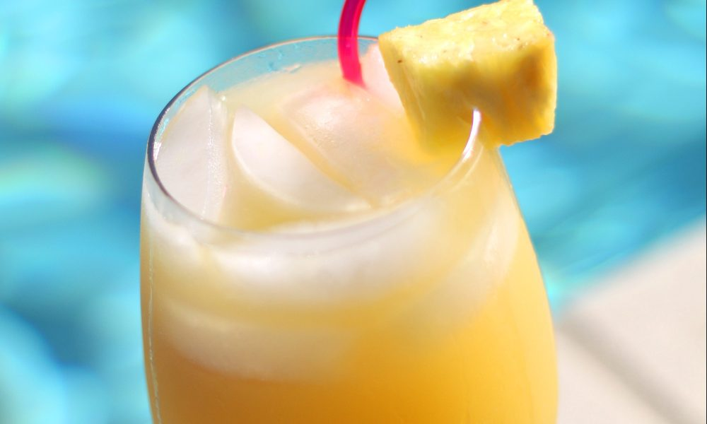 This cocktail is made with passion fruit, orange, pineapple and lemon juice mixed with dark rum and grenadine for all your island-vibes.
