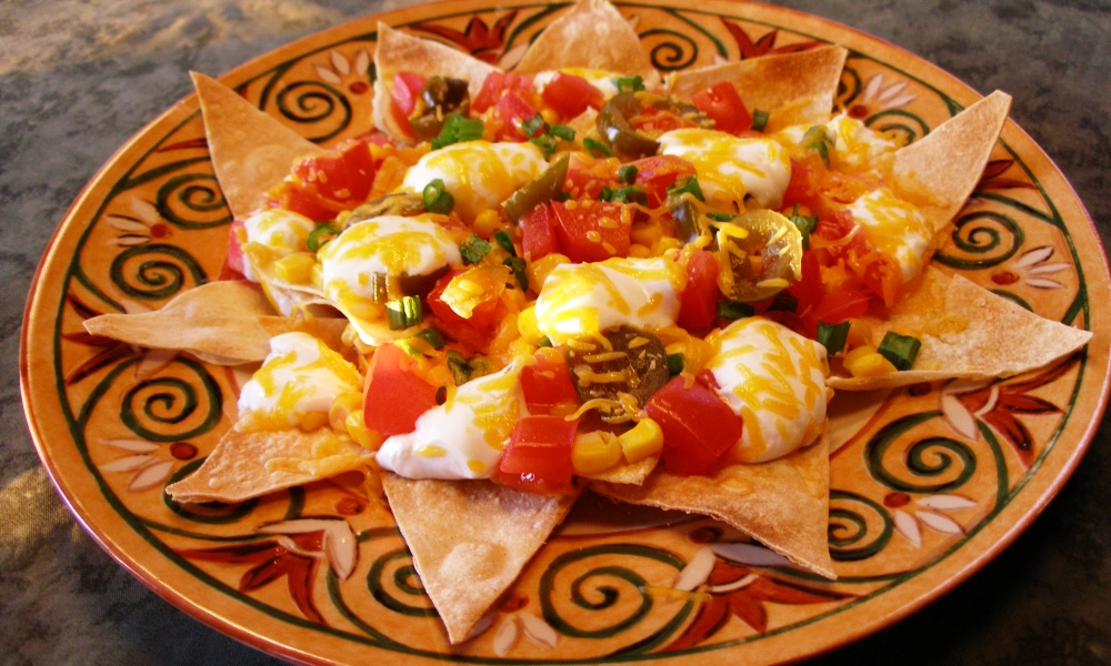 An easy and nutritious way to create a quick nibble, Downtown Nachos offer a full plate of delicious flavor that delivers one chip at a time! Perfect for game day or any other gathering of friends and/or family.
