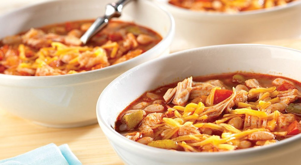 "Chili is the perfect game day party food.  This flavorful chicken chili takes less than 30 minutes and can easily be doubled. For ease of serving, place the chili in a slow cooker on the ""warm"" setting and offer toppings such as sour cream, diced avocado or corn chips to allow guest to customize!"