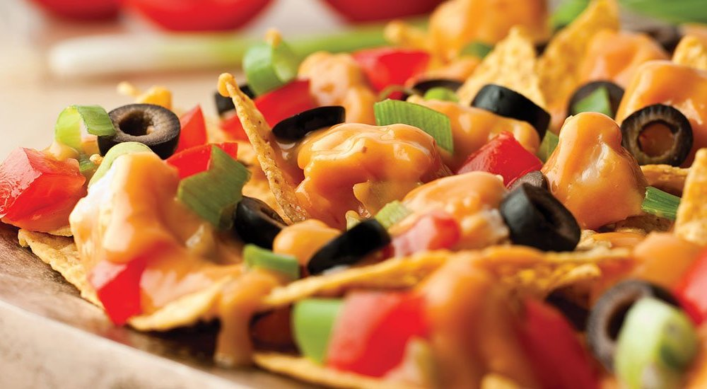 For game day or any gathering, this recipe is a winning party favorite.  These cheesy chicken nachos can be ready to serve in just 15 minutes, and they are sure to keep spirits high as you cheer on the team.