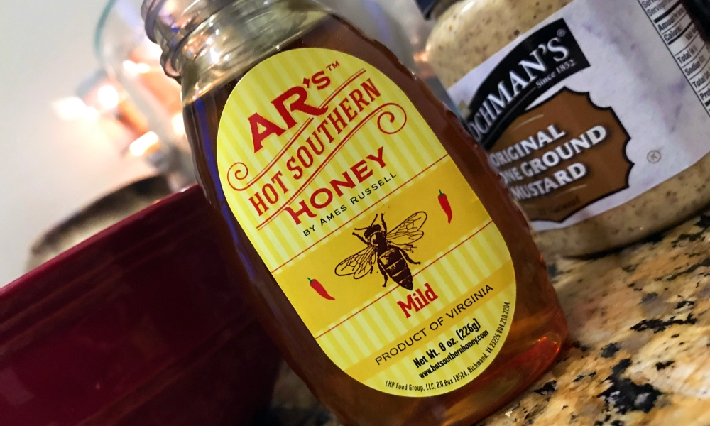 "Upon first tasting the Hot Southern Honey, using my finger, the ultimate honey dipper, I was surprised at how the taste progressed. It starts sweet and rich like an all-natural honey should, but the flavor changes as it hits your palate, finishing with the perfect amount of heat. The company's slogan is, ""Where Sweet Meets Heat!"" and it's fitting. The honey couldn't be described as spicy, it isn't a spicy flavor, but rather a gradual and subtle heated finish of chili infusion."