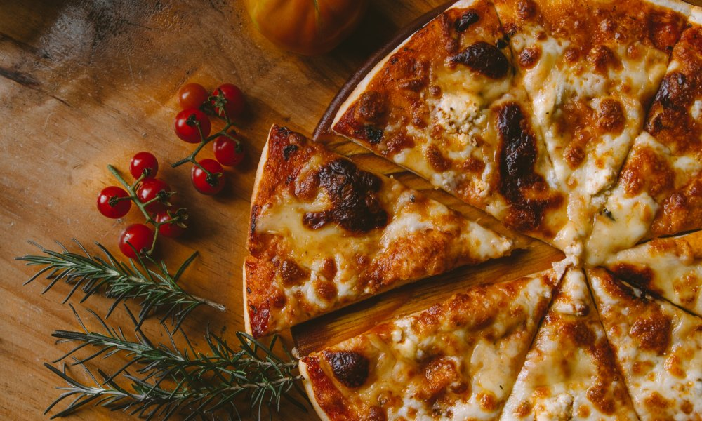 Personally, we think pizza should be celebrated year-round, but we won't fight an entire day dedicated to one of the world's greatest and most versatile dishes. Think about it, the term 'pizza' encompasses such a large variety of potential ingredients, methods of cooking, and regional preferences.