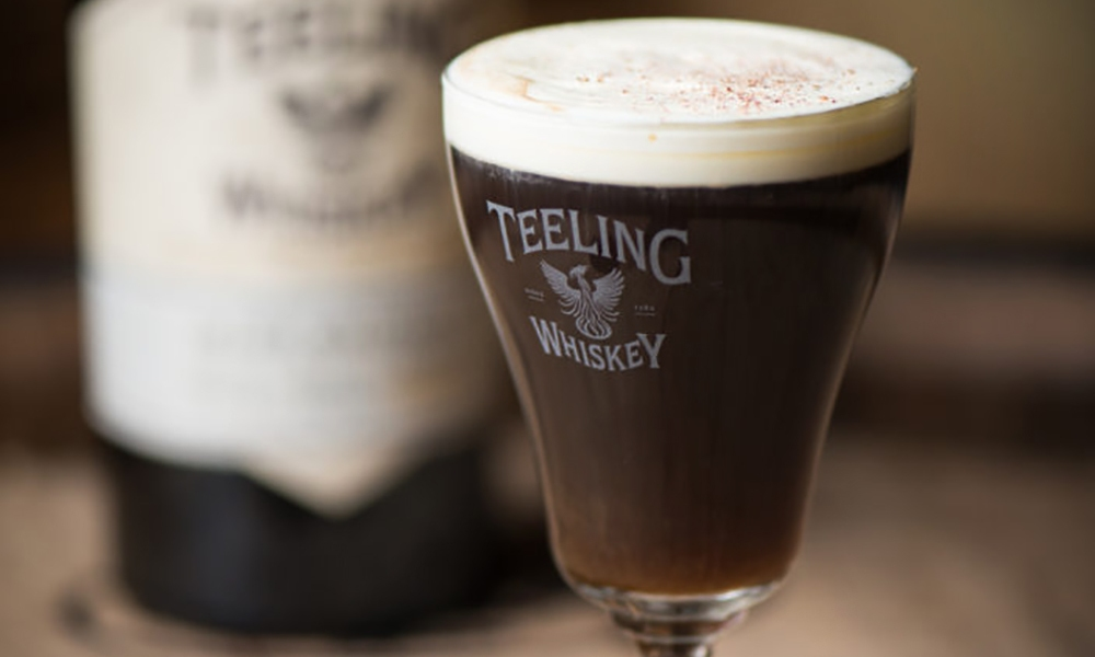 A take on the traditional Irish Coffee, this Teeling Whiskey Irish Coffee is made with Teeling Small Batch Whiskey, orange zested cream and a house-made Spiced Stout Syrup.