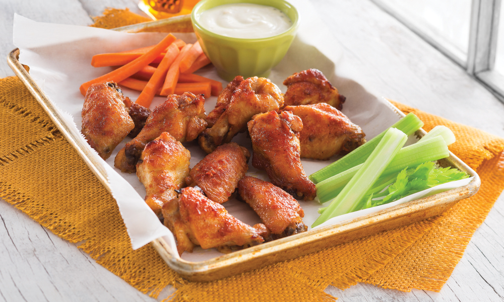 Transform the traditional chicken wing into an explosion of mouthwatering flavor with these decadent Curried Honey-Glazed Chicken Wings. Serve with blue cheese or ranch and some fresh cut veggies for the ultimate entree.