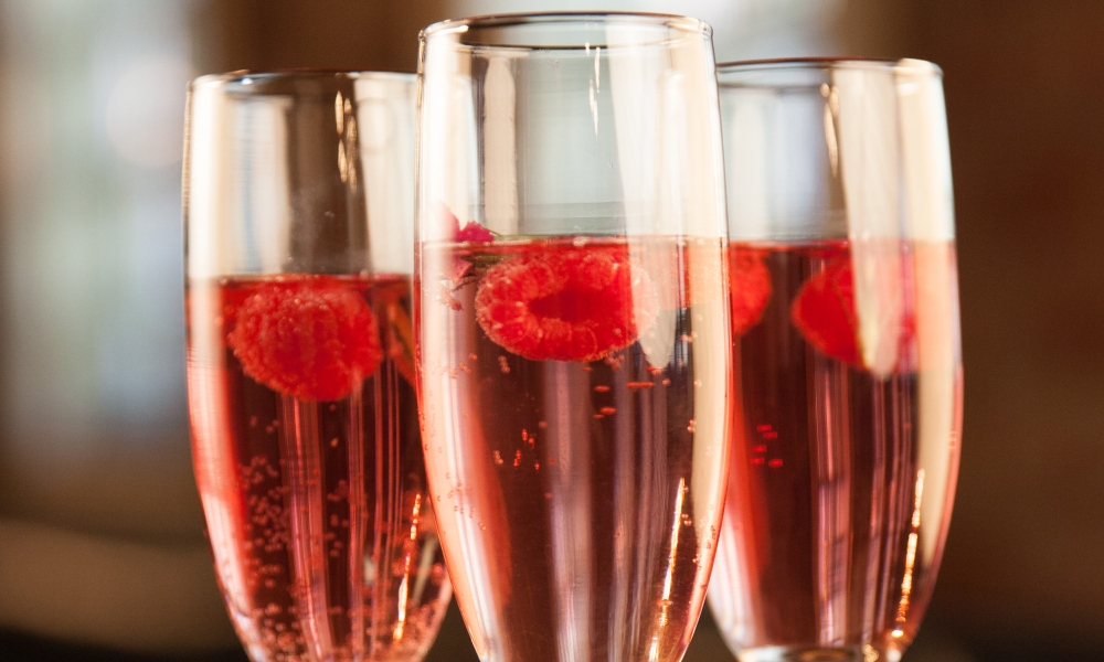 Your royal wedding watch-party won't be the same without the Honey Berry Royale cocktail! Made with macerated honey raspberries, fresh raspberries, citrus and sparkling wine, it's sure to delight.
