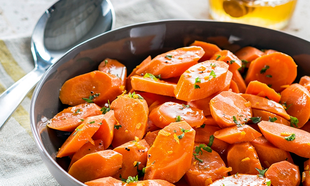 Glazed carrots are a great side dish to any entree, with the sharp tang of citrus rounded out with the sweet flavor of honey and butter.