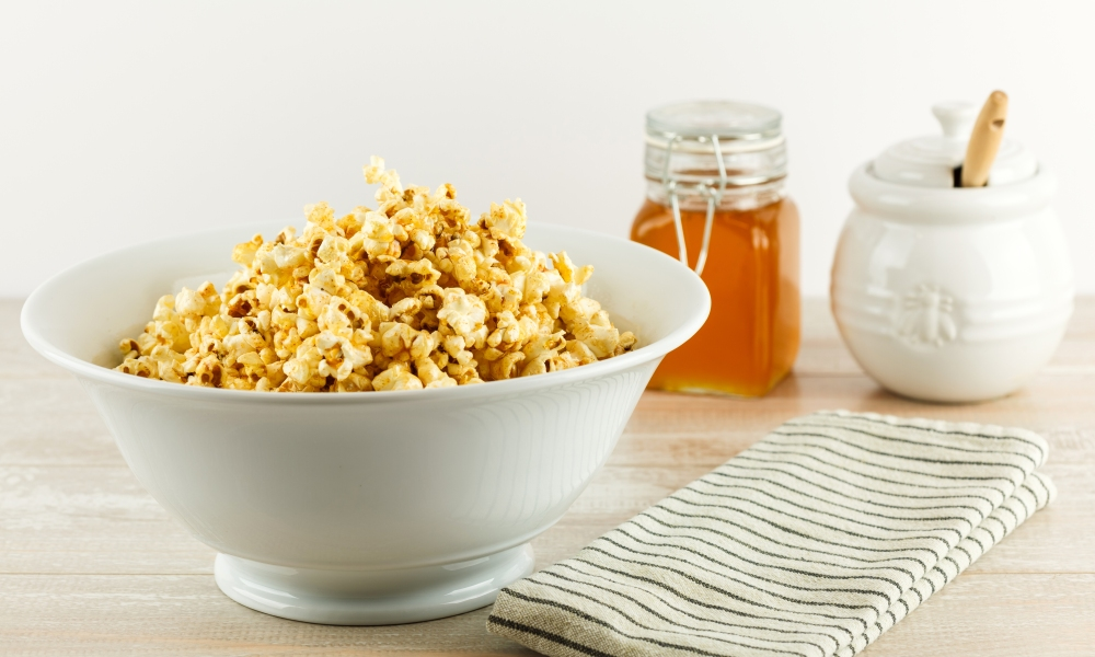 Make your movie night or game day is complete with this Sweet & Spicy Honey Popcorn, with just the right amount of heat and sweet to be completely addictive.