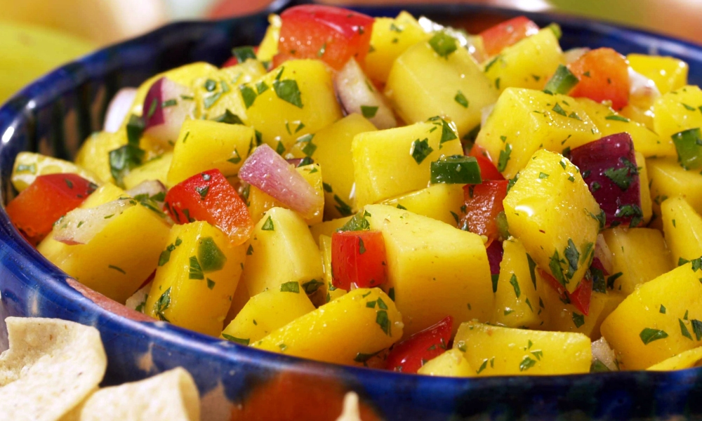 Sweet, spicy and a little tangy, this salsa is a combination of jalapeño, bell pepper, red onion, fresh cilantro, ripe mangos and a zesty blend of lime juice and seasonings. Spoon it over fresh fish tacos or baked chicken and you have a great weeknight meal.