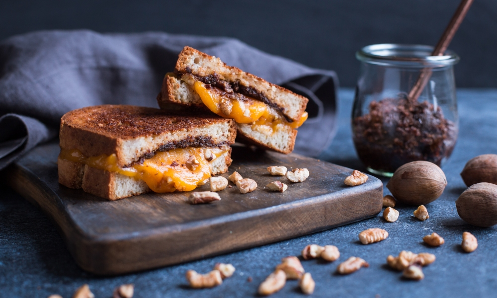 A classic sandwich gets a fresh, nutritious twist in this Grilled Cheese with Pecan and Sun-dried Tomato Spread.