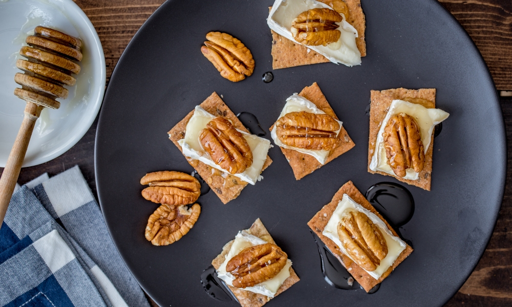 By combining four pantry staples, you can whip up this flavorful and simple Pecan Brie Honey Crostini appetizer in less than 10 minutes!