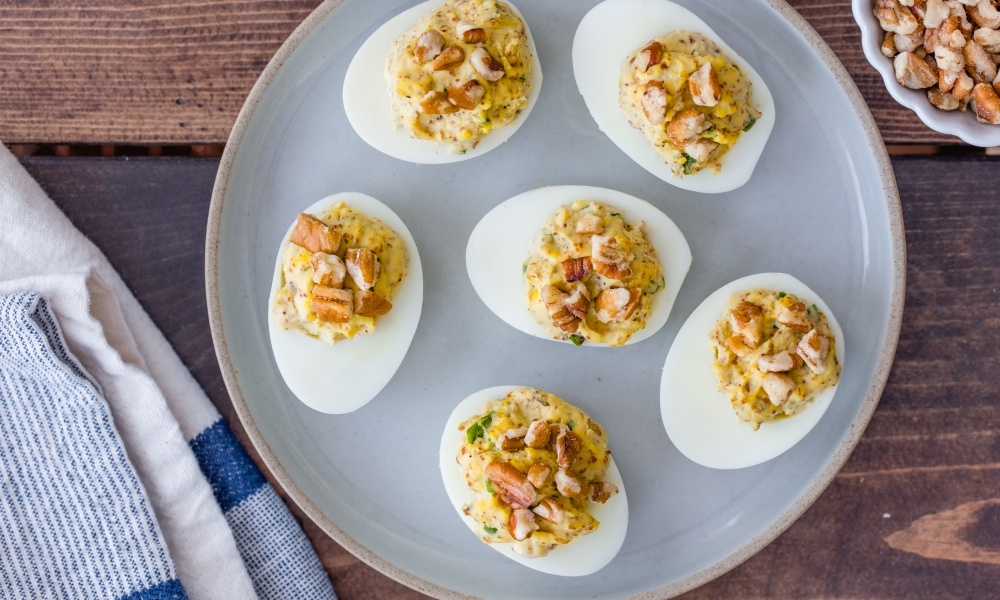 Add a naturally sweet crunch to this classic appetizer dish with this recipe for Pecan Deviled Eggs. Perfect to serve as a nutritious finger food for a spring gathering.