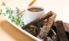 These smokey pork 'fries' are easy-to-eat, hand-held pork shoulder bites made with apple cider, dijon mustard, buckwheat honey, herbs, spices, and cornmeal.