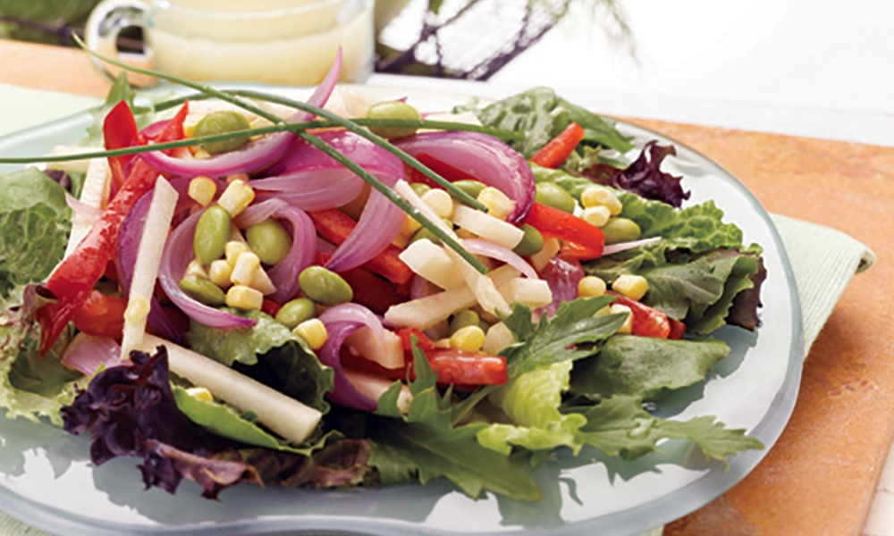 This mouthwatering sweet veggie onion salad, made with corn, jicama, edamame and sweet bell peppers is perfectly complemented by a tangy homemade Margarita Dressing.