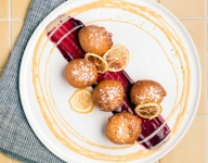 Buñuelos with White Chocolate Sauce and Berry Compote