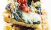 An impressive and incredibly easy tart! Loaded with flavor from roasted chiles, tomatoes, and cheese; making a great appetizer.