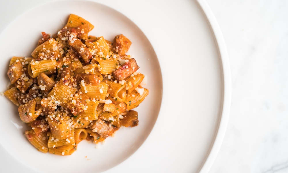 A seafood variety of Rigatoni, this spicy tomato pasta dish combines the rich flavor of tomato with ahi tuna and bonito flakes.
