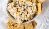 My neighbors a couple of doors down have a pool, and every Memorial Day they invite a few of the neighbors over for swimming and grilling. They always make a corn and cream cheese dip that I tend to circle back to as I make my rounds. This version is inspired by that Memorial Day dip, but I replaced full-fat cream cheese with a lighter version and added more veggies.