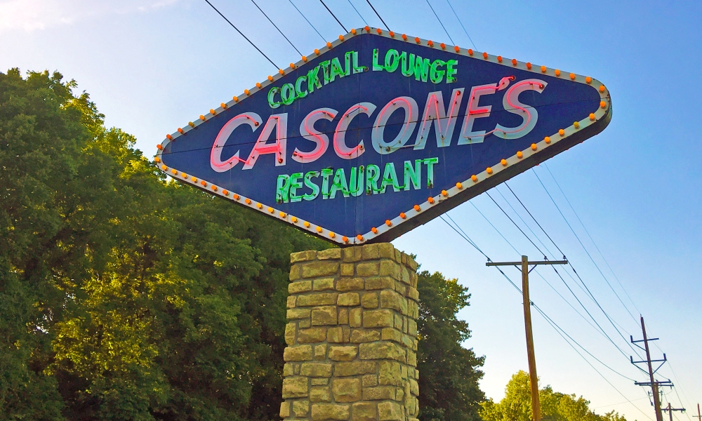 "When a restaurant has a memorial bench placed out front, you know there's a story. That's what we found at Cascone's in Kansas City, MO while passing through what's usually called ""flyover land."""
