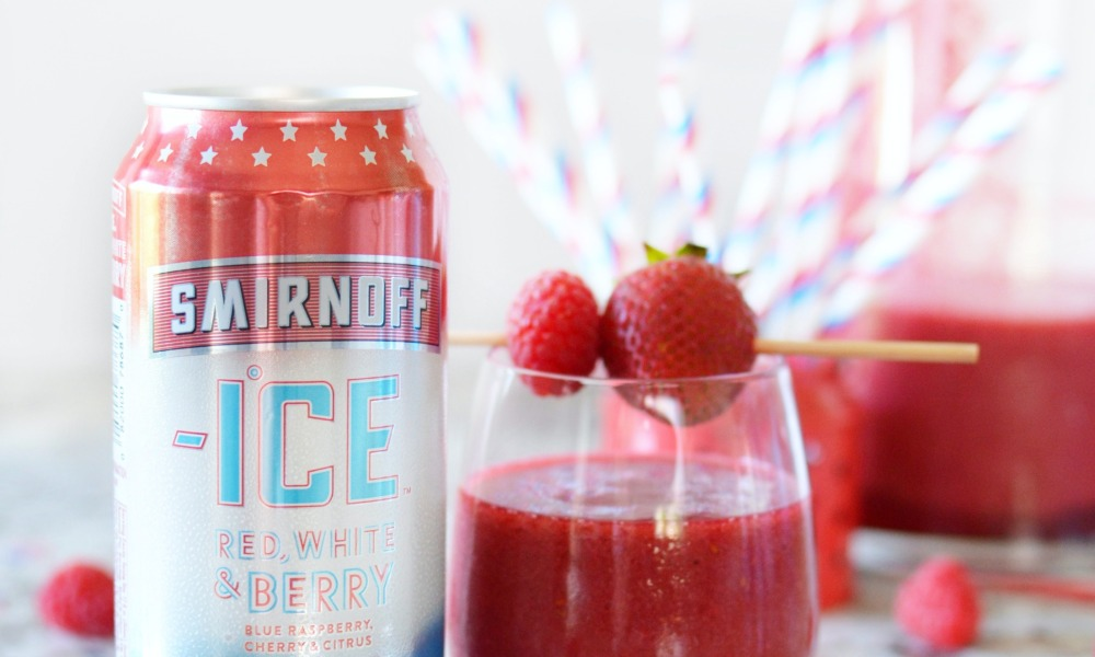 A delicious fourth of July lemonade cocktail made with Smirnoff Ice's Limited Edition Red, White and Berry.