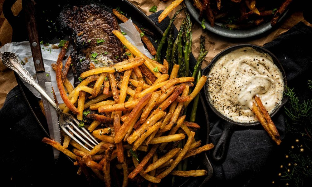 These bold matchstick fries are perfect for entertaining - an elegant spin on everyone's favorite snackable side dish. Thinly pan baked, with a crisp duck fat crunch and an aromatic blend of roasted garlic and herbs has everyone rushing to nibble.